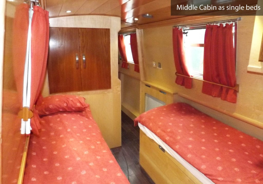 Wily Fox boat page cabin as twin