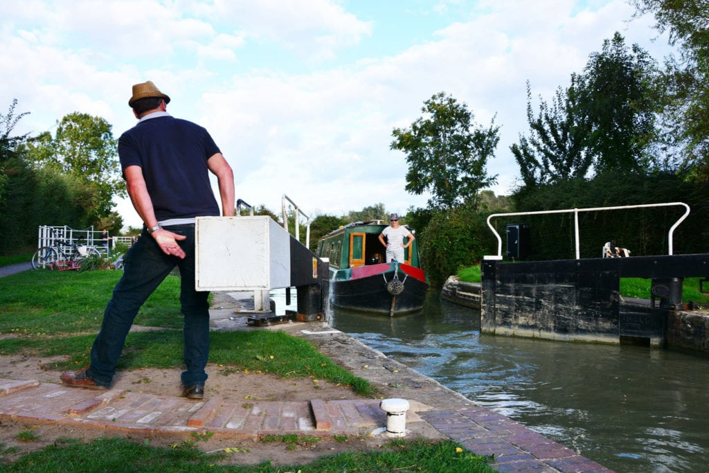 Happy Hire Boat holiday makers operating the locks on the Kennet and Avon