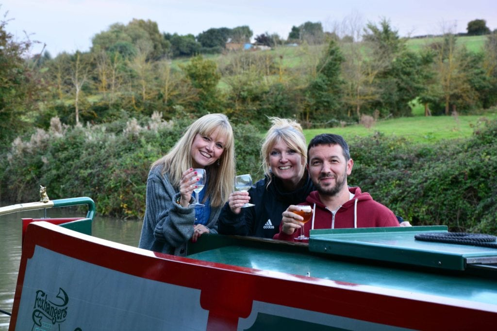 A group of freinds relaxing on their canal boat holiday