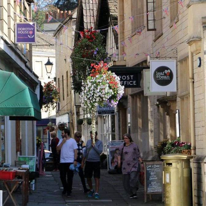 Holiday makers enjoying the quaint market towns and villages along the canal