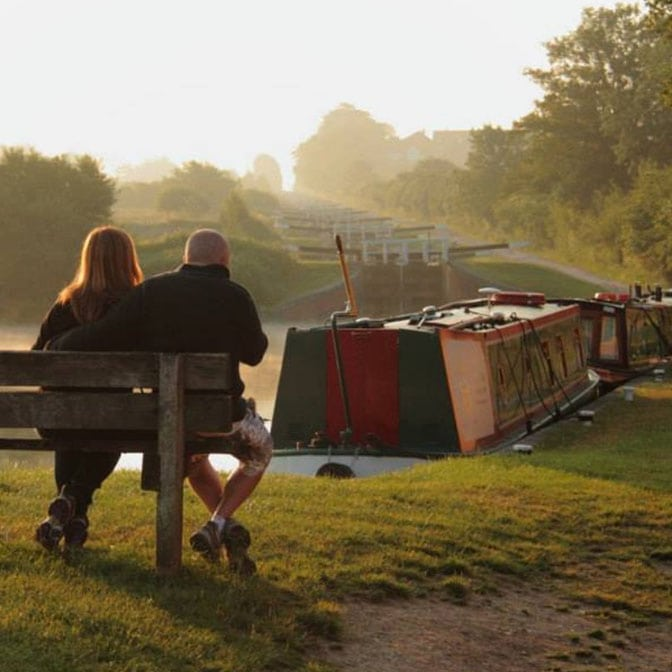 Couple enjoying a Foxhangers Hire Boat Holiday by Caen Hill Locks, Devizes
